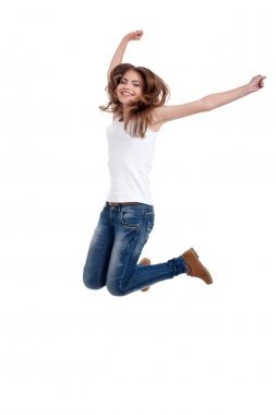 Happy teen girl jumping, isolated on white background