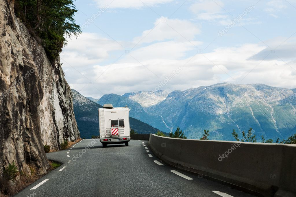 Road with motor home in mountains