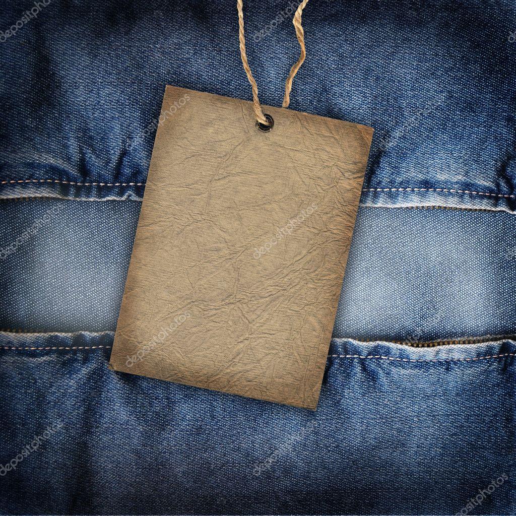 Background denim texture with cardboard label u2014 Stock ...