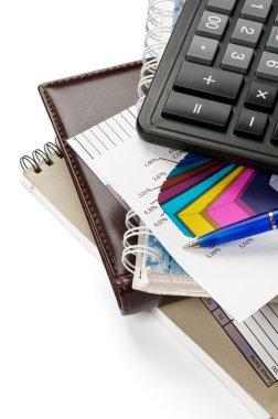 Arrangement of office supply, calculator and blocks