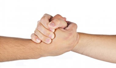 Arm wrestling hands of two men isolated
