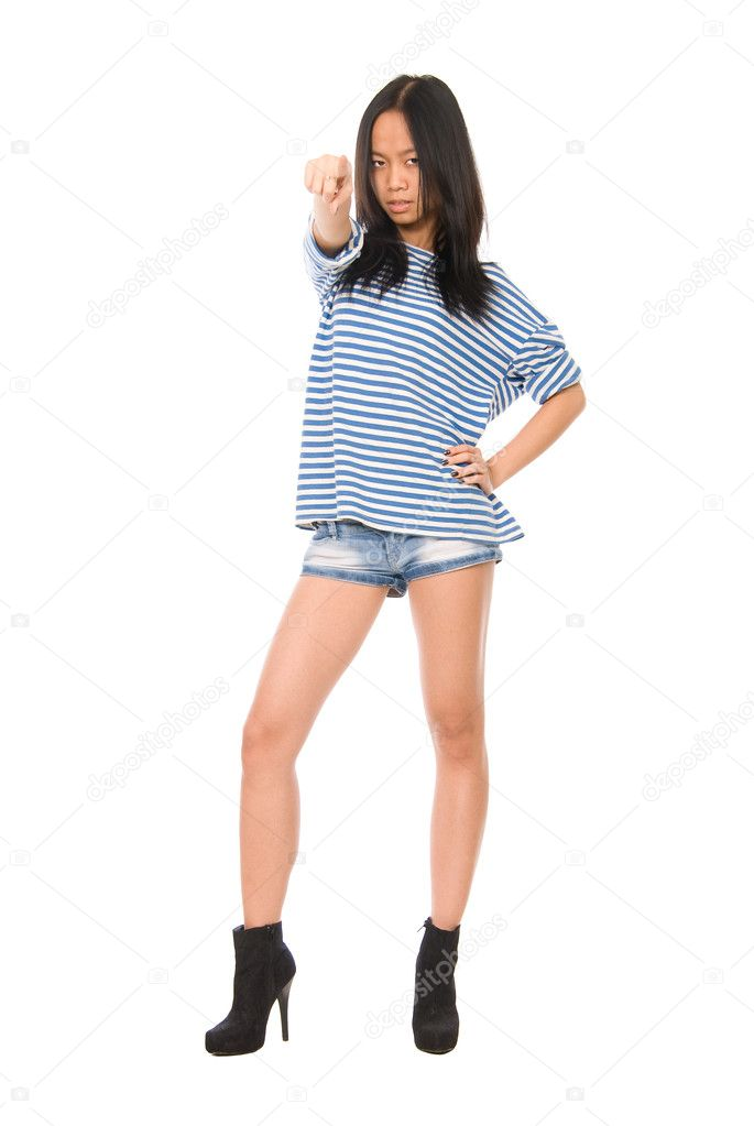 Asian girl in a striped T-shirt pointing against