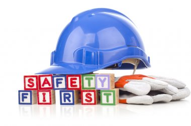 Safety first word blocks with personal protective equipment isolated on white background stock vector