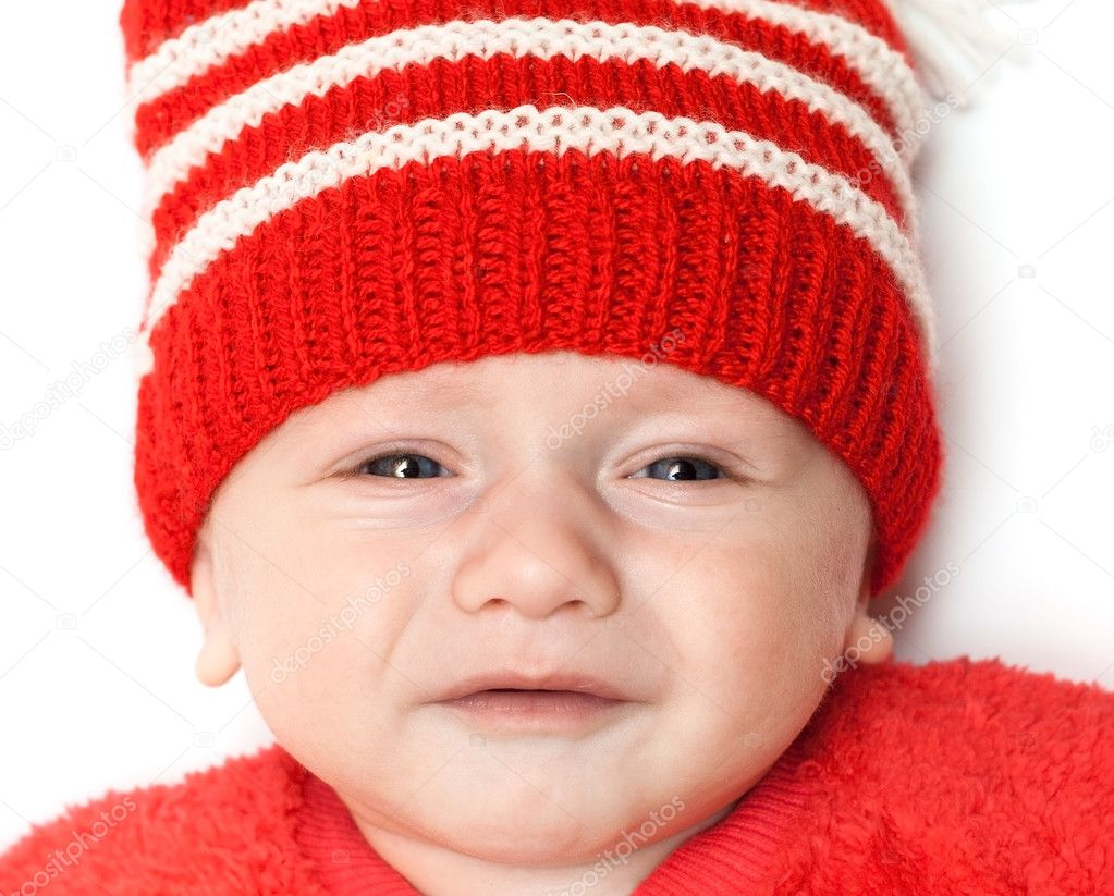 Baby boy in red hat looking very upset. over white with shadow — Photo by  depfotovampir 9c4af1f4a3d