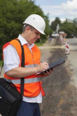 Engineer near the road repair work