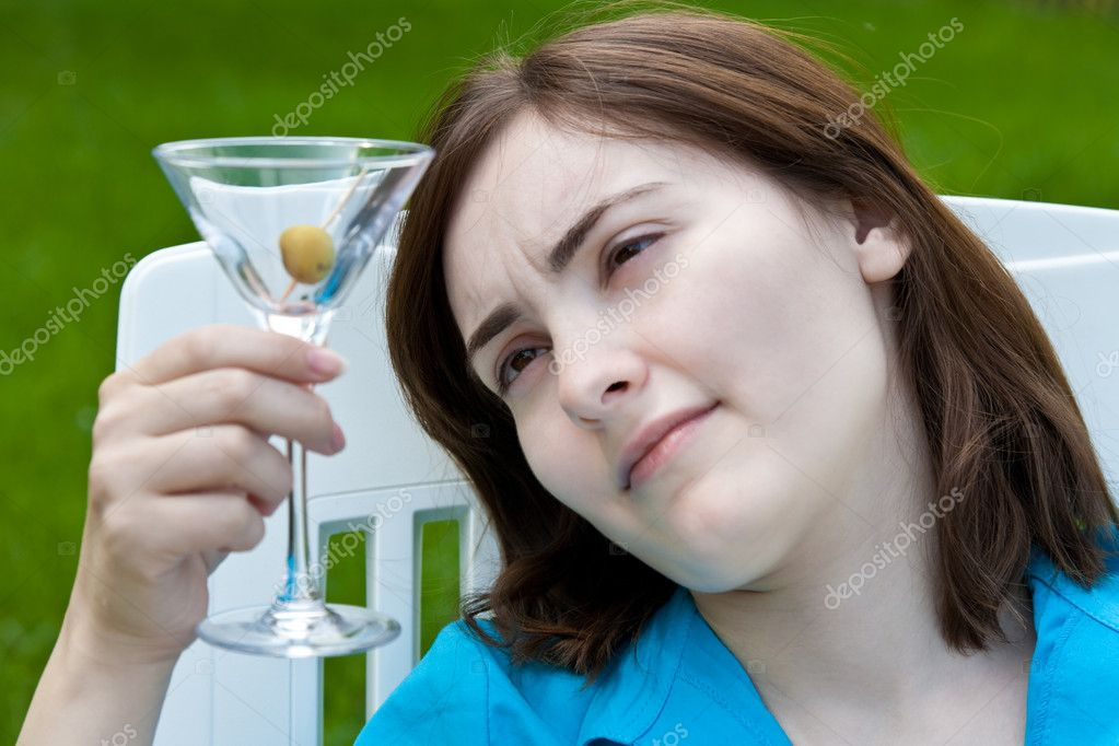 Woman with wineglass outdoors