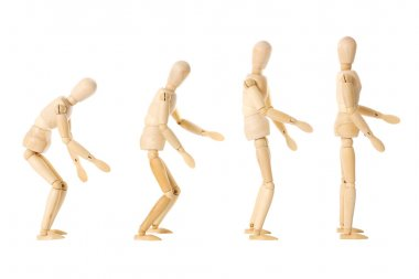 Wooden dolls with different postures