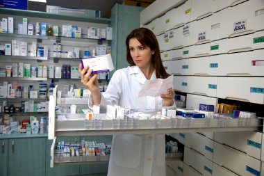 Pharmacist woman looking for medicine
