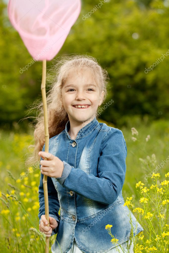 Girl with a net catching butterflies