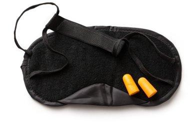 Black sleeping mask and earplugs