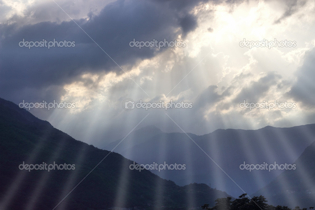 Ray of lights over Italian Alps