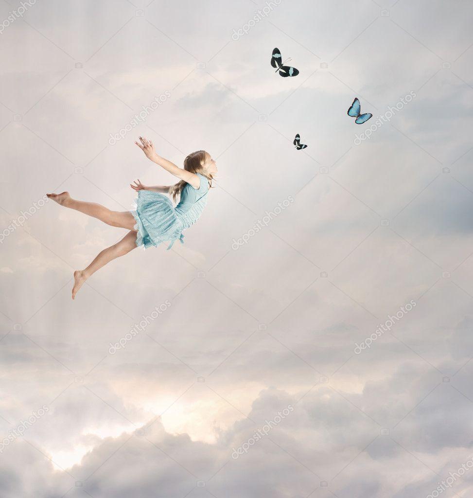 little girl flying at twilight � stock photo 169 melpomene