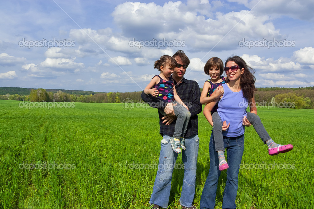 Happy family outdoors having fun
