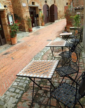 Garden furniture on italian narrow street i