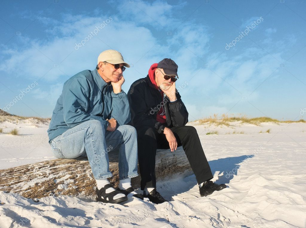 Two Bored Retired Men Seated at the Beach