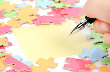 Note paper and puzzle with pen