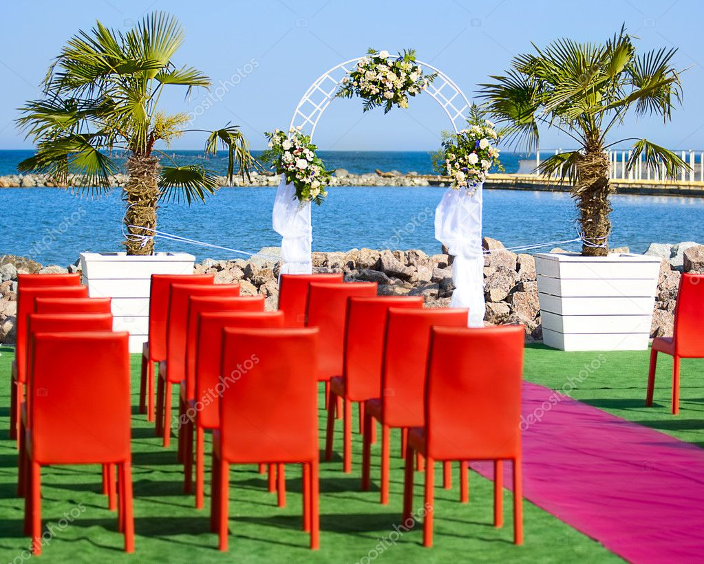 White wedding arch on the beach