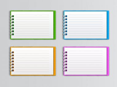 Collection of open white notebook