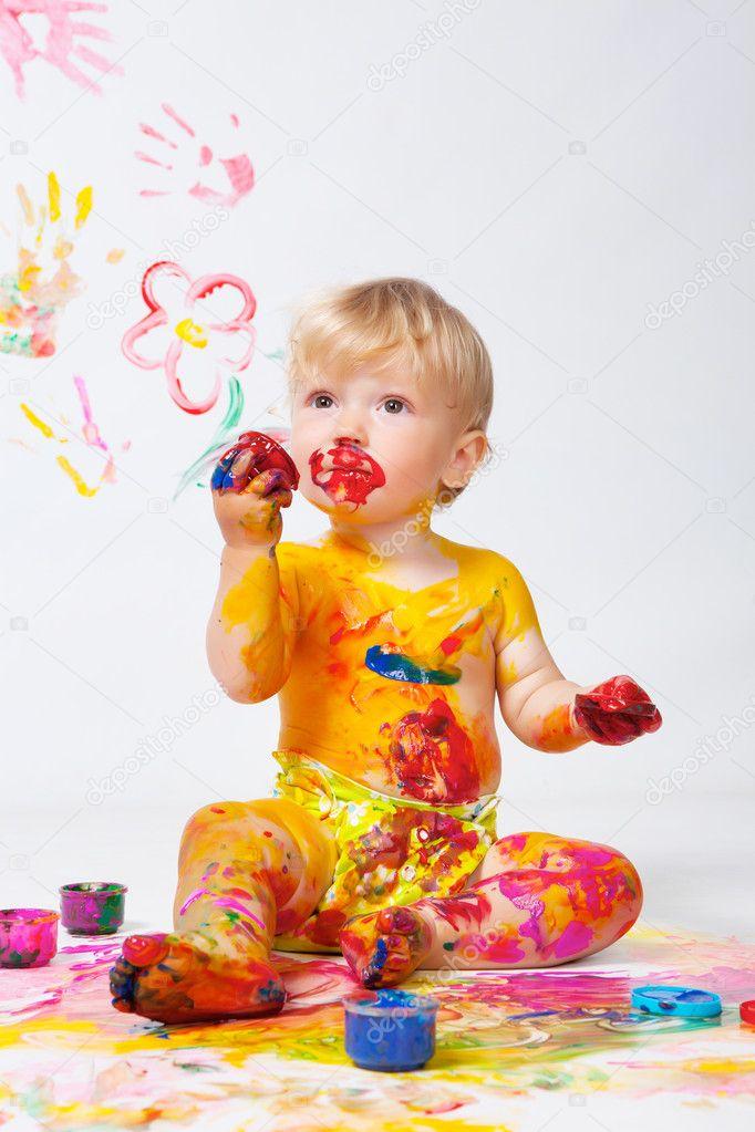 Little girl painting in studio