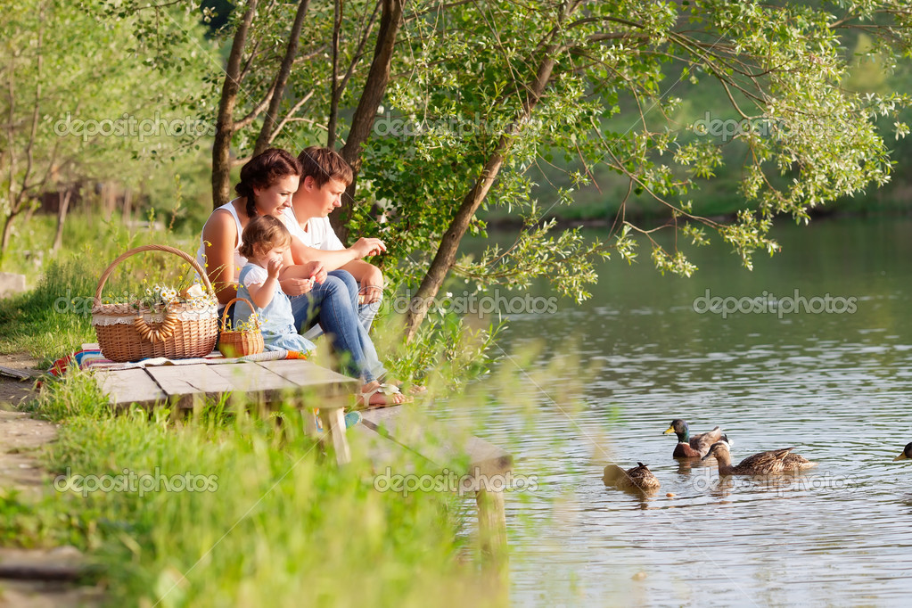 Family on the picnic near the lake