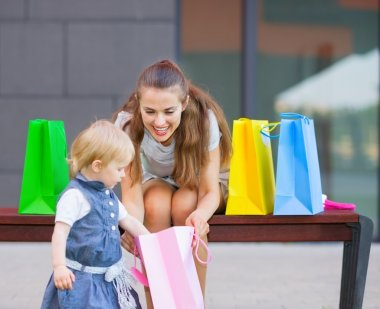 Mother and baby examines purchases after shopping
