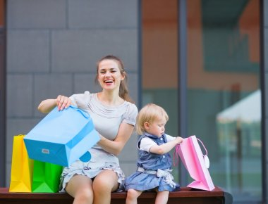 Mother and kid examines purchases after shopping