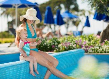 Mother with baby enjoying pool