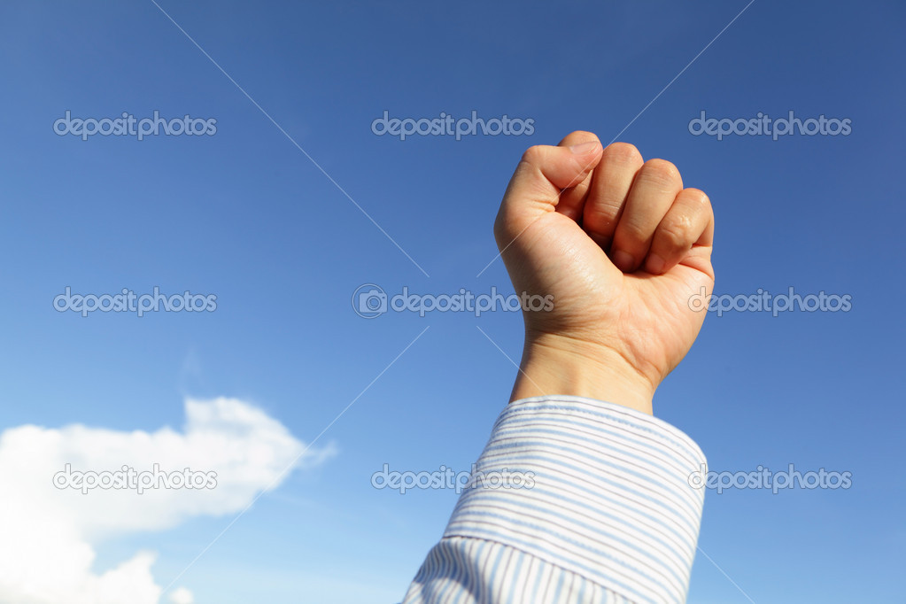 Successful business man hand fist gesture