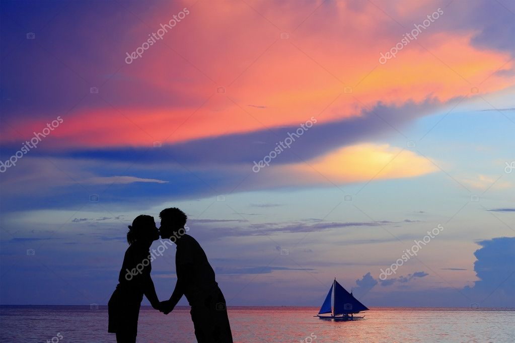 Silhouette of a young bride and groom in beach