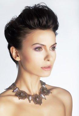 Fashionable elegant lady with jewels