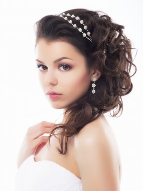 Wedding style - gentle young fiancee. Festive coiffure and makeup