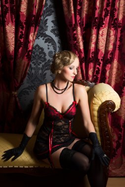 Red curtains and vintage lady