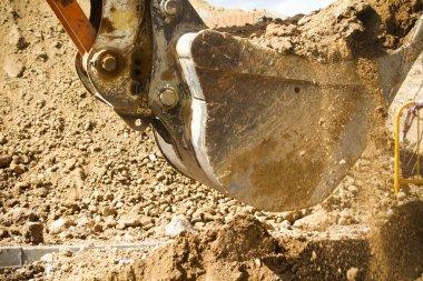 Wheel loader machine unloading sand at eathmoving works in const