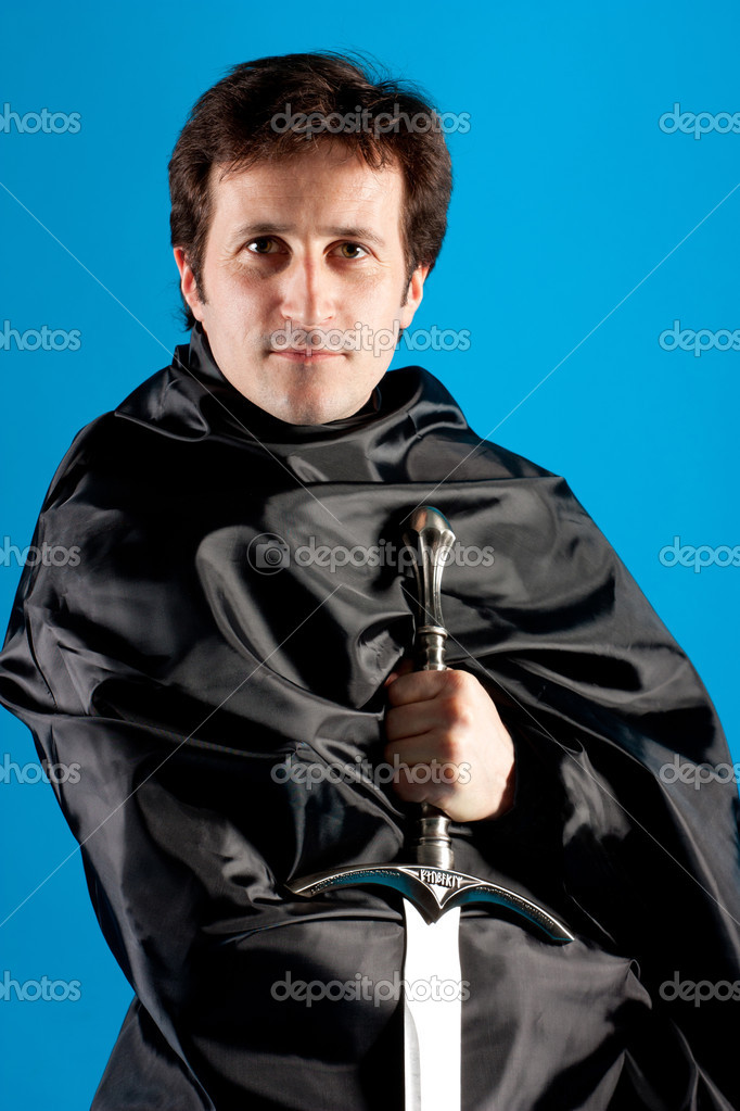 Portrait of man with knight sword