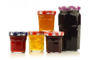Glass jars with assorted jam and marmalade