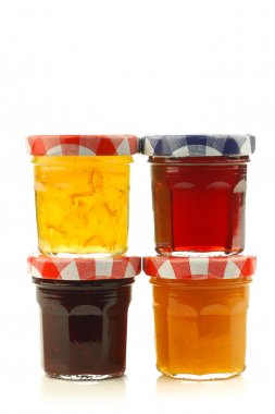 Stacked glass jars with assorted jam and marmalade