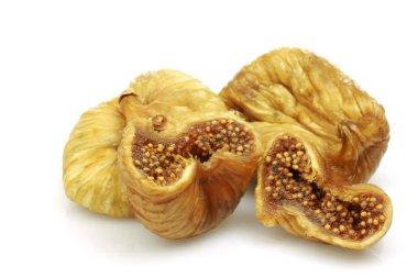 Three dried and one cut fig