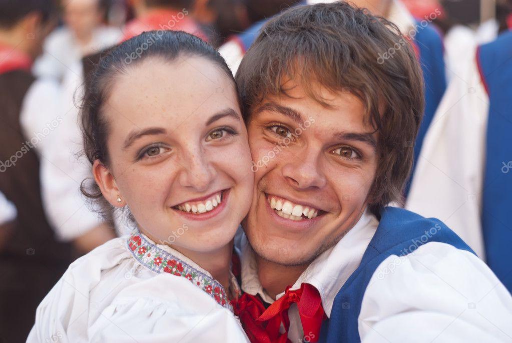 Smiling poland folk couple