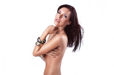 Attractive woman without clothes with cheetah pattern makeup and bracelets