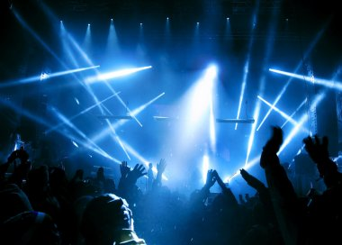 Silhouettes of and musicians in big concert stage. Bright beautiful rays of light stock vector