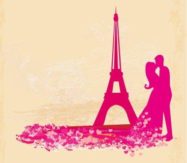Romantic couple in Paris kissing near the Eiffel Tower. Retro card.
