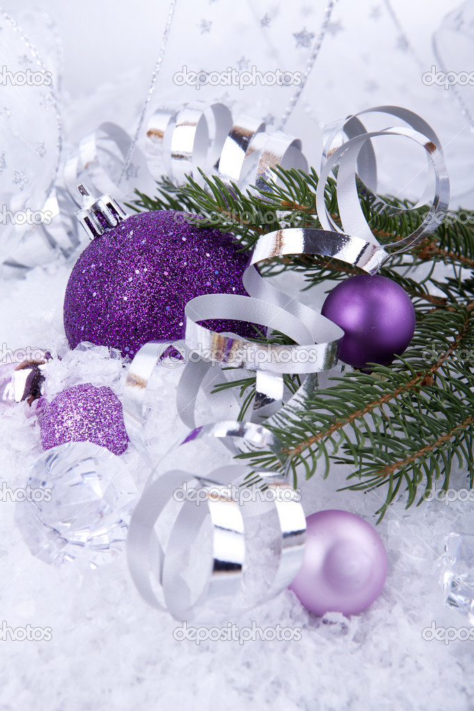 beautiful christmas decoration in purple and silver on white snow sparkle photo by nilswey