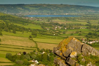 View from Crook Peak towards Cheddar Reservoir in Somerset England