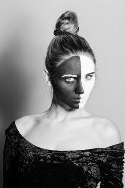 Woman witn dual greasepaint looks