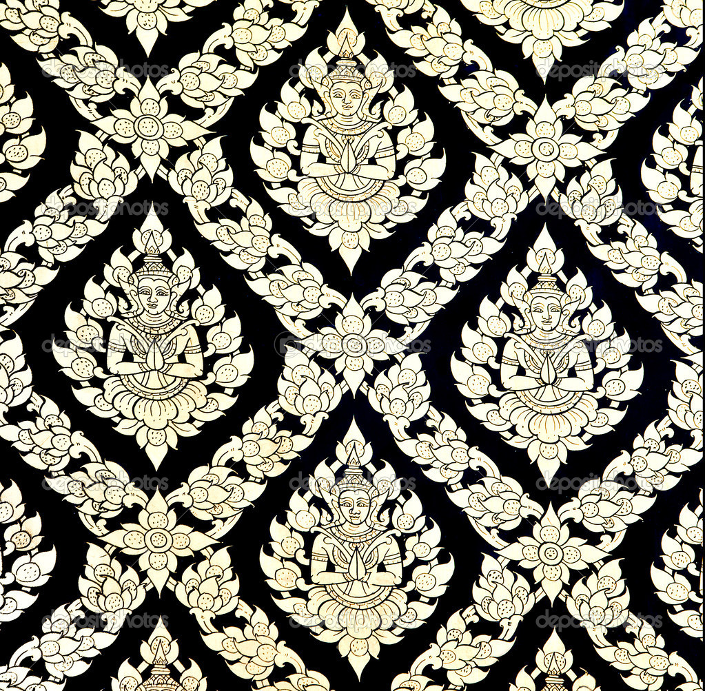 The Traditional Thai style art golden painting pattern on the wa