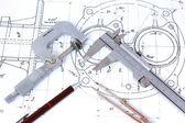 Fotografie Micrometer, Caliper, Mechanical Pencil and Compass on Blueprint