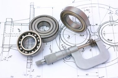 Ball bearings with micrometer on technical drawing