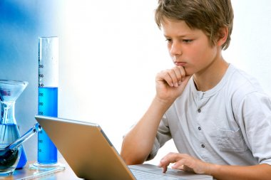 Young science student with laptop.