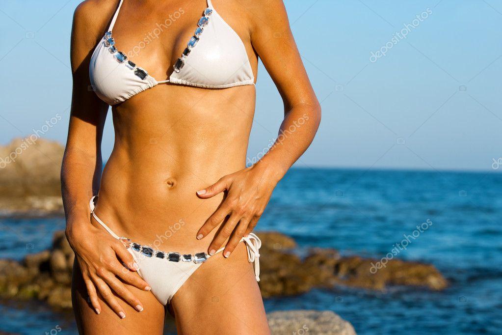 Attractive female body in bikini.