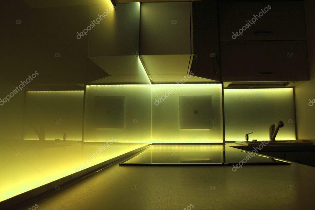Küche mit gelben led Beleuchtung — Stockfoto © PromesaStudio #11728619